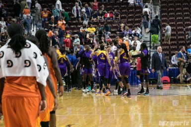The Los Angeles Sparks celebrate their 87 -79 win over the Connecticut Sun.