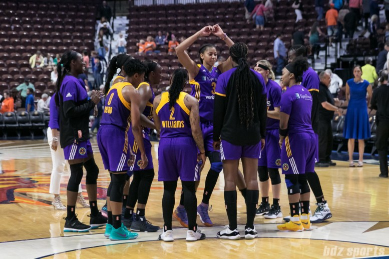 Los Angeles Sparks forward Candace Parker (3) dances in the circle formed of her teammates after the Sparks' 87 - 79 win over the Connecticut Sun.