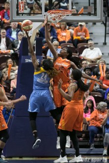Connecticut Sun center Jonquel Jones (35) looks to block the lay up from Chicago Sky forward Keisha Hampton (24).