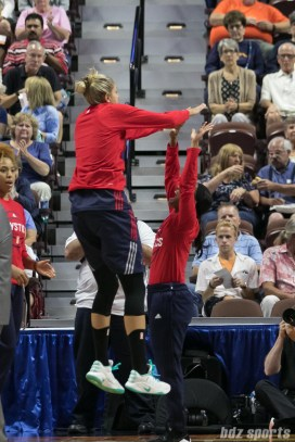 Washington Mystics forward Elena Delle Donne (11) high fives guard Tierra Ruffin-Pratt (14) prior to the start of the game.