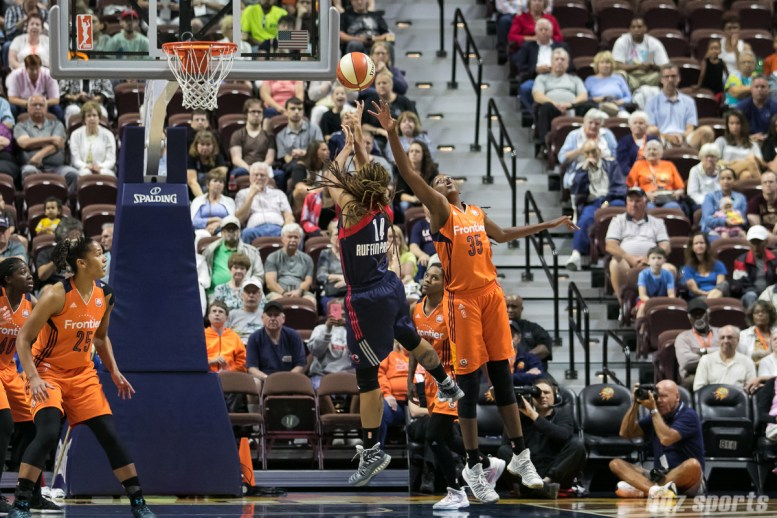 Washington Mystics guard Tierra Ruffin-Pratt (14) takes a shot past he arm of Connecticut Sun center Jonquel Jones (35).
