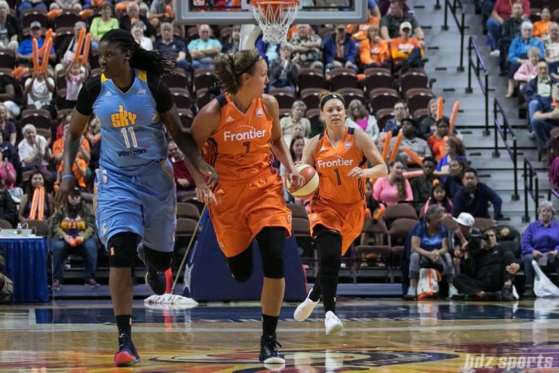 Connecticut Sun guard Rachel Banham (1) brings the ball up the court.