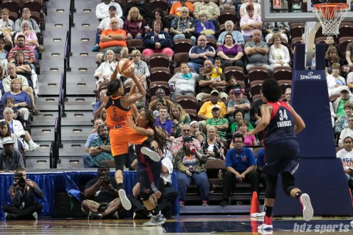 Connecticut Sun guard Jasmine Thomas (5) takes a shot over Washington Mystics guard Tierra Ruffin-Pratt (14).