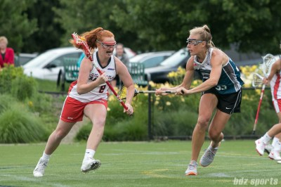 Boston Storm midfielder Hannah Murphy (8) looks to get by Philadelphia Force attacker Michele Tumolo (35).