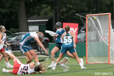 Boston Storm attacker Elisabeth Jayne (22) looks on from the ground as her shot hits the top of the net.