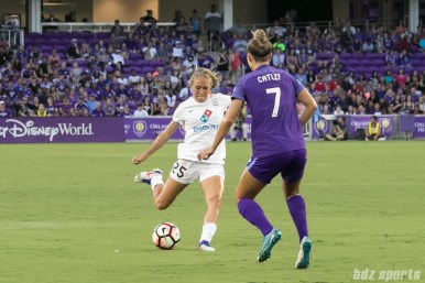 FC Kansas City forward Brittany Ratcliffe (25) takes a shot on goal as Orlando Pride defender Steph Catley (7) closes in.