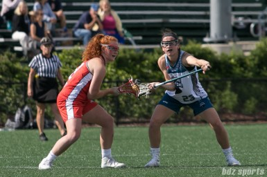 Boston Storm midfielder Hannah Murphy (8) and Philadelphia Force Lauren Murray (23) prepare for the faceoff.