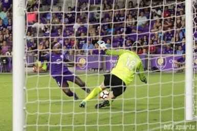 Orlando Pride forward Chioma Ubogagu (6) and FC Kansas City goalkeeper Nicole Barnhart (18) slide for a dangerous ball in front of FC Kansas City's goal.