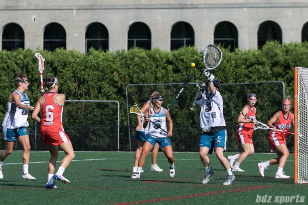 Philadelphia Force goalie Emily Leitner (99) makes a save on the shot from Boston Storm midfielder Ali Flury (6).