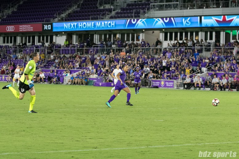 Orlando Pride midfielder Kristen Edmonds (12) steals the ball away from FC Kansas City goalkeeper Nicole Barnhart (18) and puts away the ball in an open net for the Pride's fourth goal of the game.