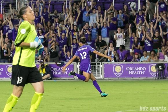 Orlando Pride midfielder Kristen Edmonds (12) celebrates her goal.