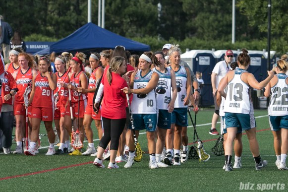 Players on the Boston Storm and Philadelphia Force shake hands after the game. The Storm advance to the championships after defeating the Force 13-10 at Jordan Field.