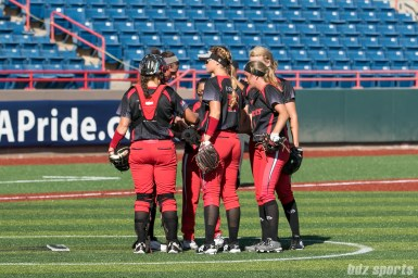 The Akron Racers infielders huddle before the start of the fourth inning.