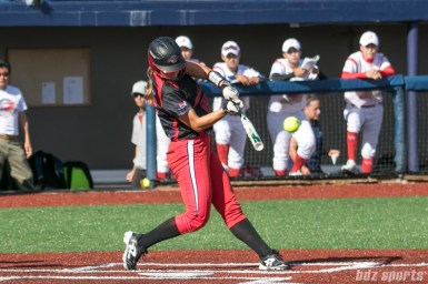 Akron Racers outfielder Nicole Schroeder (29) makes contact with the ball.