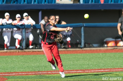 Akron Racers third baseman Kelley Montalvo (10) makes a throw to first base for the out.