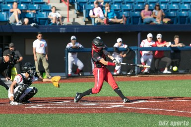 Akron Racers infielder Sam Fischer (52) makes contact with the ball.