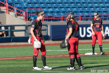 Akron Racers pitcher Jailyn Ford (12) and Akron Racers catcher Griffin Joiner (13) talk on the mound.