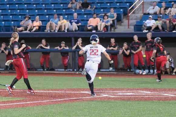USSSA Pride utility player Hallie Wilson (22) scores on a wild pitch.