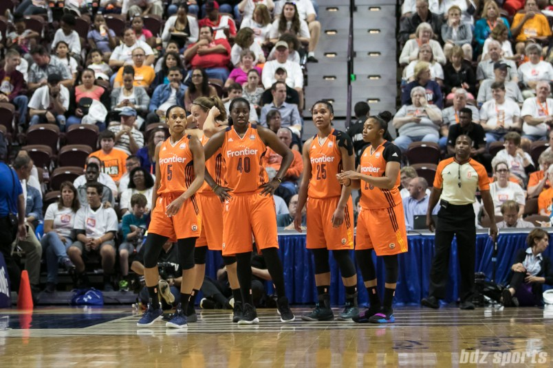 Connecticut Sun players Jasmine Thomas (5), Shekinna Stricklen (40), Alyssa Thomas (25), and Alex Bentley (20) look to match up against the Seattle Storm players.