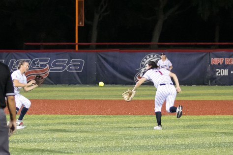 USSSA Pride infielder Mo Mercado (7) throws straight from the glove for the force out at second base.