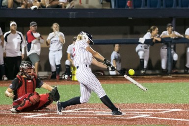 USSSA Pride utility player Hallie Wilson (22) makes contact with the ball.