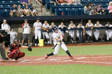 USSSA Pride outfielder Kirsti Merritt (24) makes contact with the ball for a base hit.