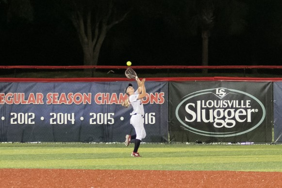 USSSA Pride outfielder Kirsti Merritt (24) makes the grab for the out.