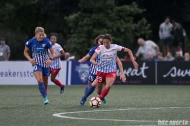 Chicago Red Stars forward Christen Press (23) controls the ball in the midfield.