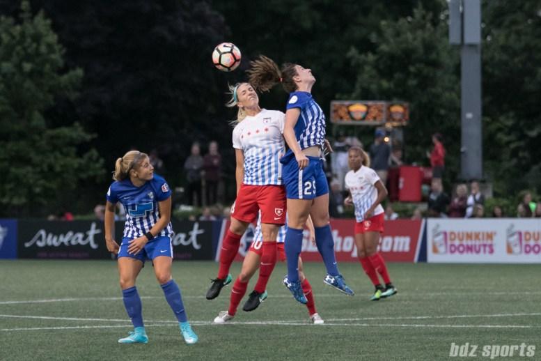 Chicago Red Stars defender Julie Ertz (8) and Boston Breakers midfielder Morgan Andrews (25) battle for a ball in the air.