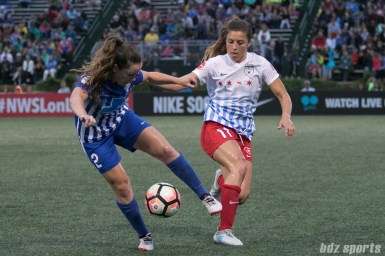 Boston Breakers defender Allysha Chapman (2) looks to control the ball away from Chicago Red Stars forward Sofia Huerta (11).