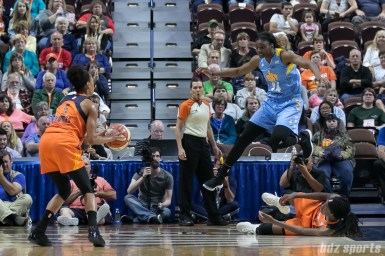 Chicago Sky forward Keisha Hampton (24) leaps over Connecticut Sun center Jonquel Jones (on the floor) to defend against Sun guard Jasmine Thomas (5).