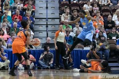 Chicago Sky forward Keisha Hampton (24) leaps over Connecticut Sun center Jonquel Jones (on the floor) to defend against Sun guard Jasmine Thomas (5).