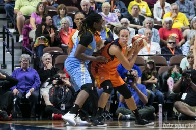 Connecticut Sun forward Kayla Pedersen (7) protects the ball against her defender.