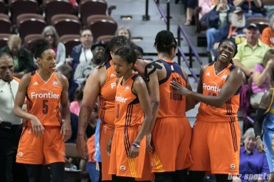 Connecticut Sun forward Shekinna Stricklen (40) is all smiles after she huddles with her teammates.