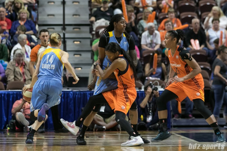 Connecticut Sun guard Courtney Williams (10) gets picked by Chicago Sky forward Jessica Breland (51).