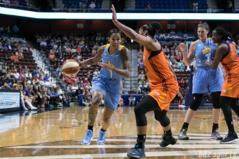 Chicago Sky forward Tamera Young (1) looks to dribble past Connecticut Sun forward Alyssa Thomas (25).
