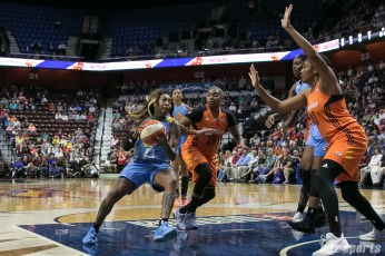 Chicago Sky guard Cappie Pondexter (23) drives to the basket against Connecticut Sun guard Alex Bentley (20) and forward Morgan Tuck (33).