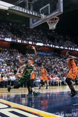 Seattle Storm forward Breanna Stewart (30) drives baseline looking to do a reverse layup.