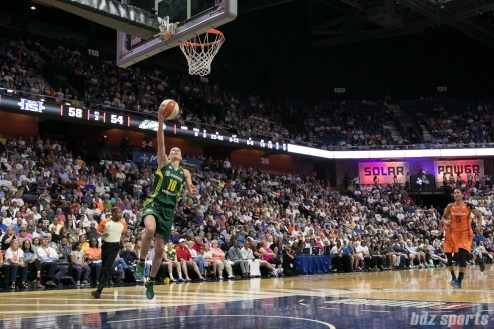 Seattle Storm guard Sue Bird (10) caps off her steal with a layup.