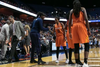 Connecticut Sun guard Courtney Williams (10) shakes hands with teammate Lynetta Kizer (12).