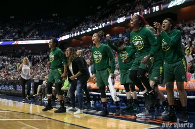 The Seattle Storm celebrating the basket by Seattle Storm forward Breanna Stewart (not pictured).