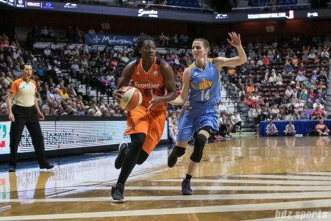 Connecticut Sun forward Shekinna Stricklen (40) drives to the hoop past Chicago Sky guard Allie Quigley (14).