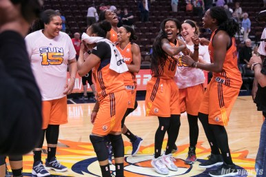 The Connecticut Sun players bust a few moves at half court post-game while waiting to take a team picture.