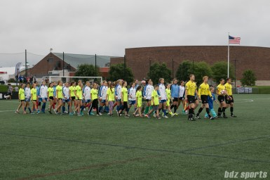 The Boston Breakers and Chicago Red Stars starting XI walk out onto the field.