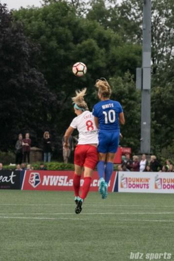 Boston Breakers midfielder Rosie White (10) challenges Chicago Red Stars defender Julie Ertz (8) for a ball in the air.