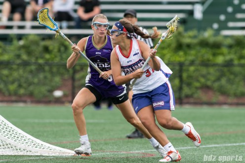 Long Island Sound attacker Halle Majorana (37) controls the ball against Baltimore Ride Sammi Burgess (9).