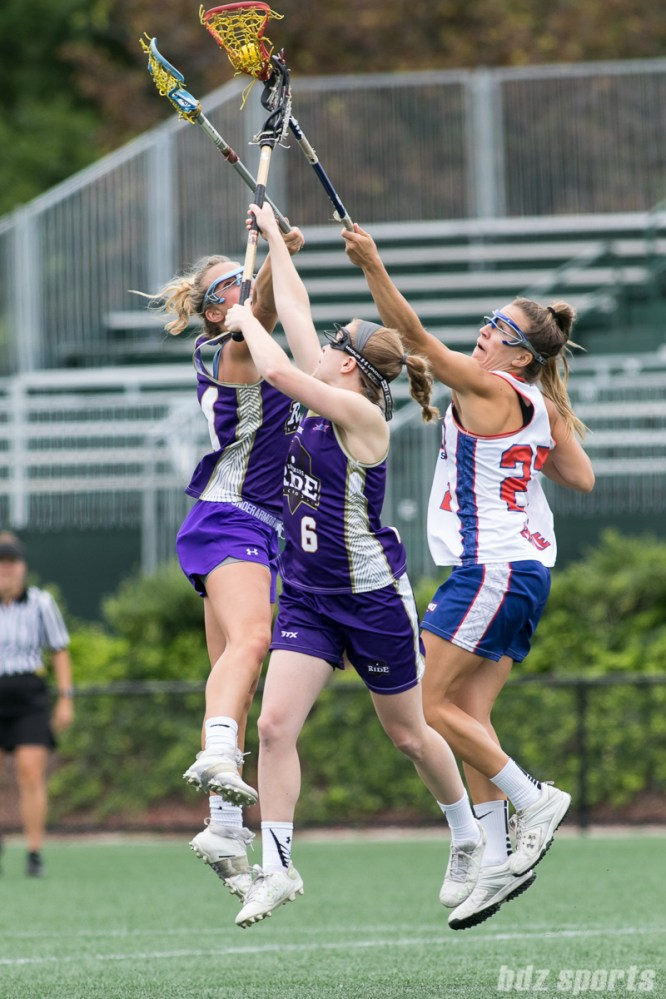 Long Island Sound midfielder Hillary Fratzke (27) wins possession of the ball.