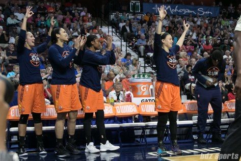 The Connecticut Sun bench celebrate a 3-pointer by teammate Shekinna Stricklen (not pictured).