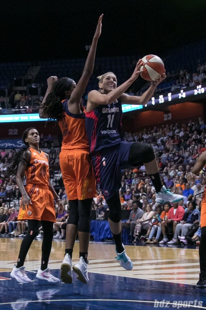 Washington Mystics forward Elena Delle Donne (11) drives to the basket under the arm of Connecticut Sun center Jonquel Jones (35).