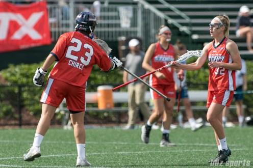 Boston Storm goalie Jackie Chirco (23) and defender Kelsey Sheridan (32) celebrate a Storm goal.